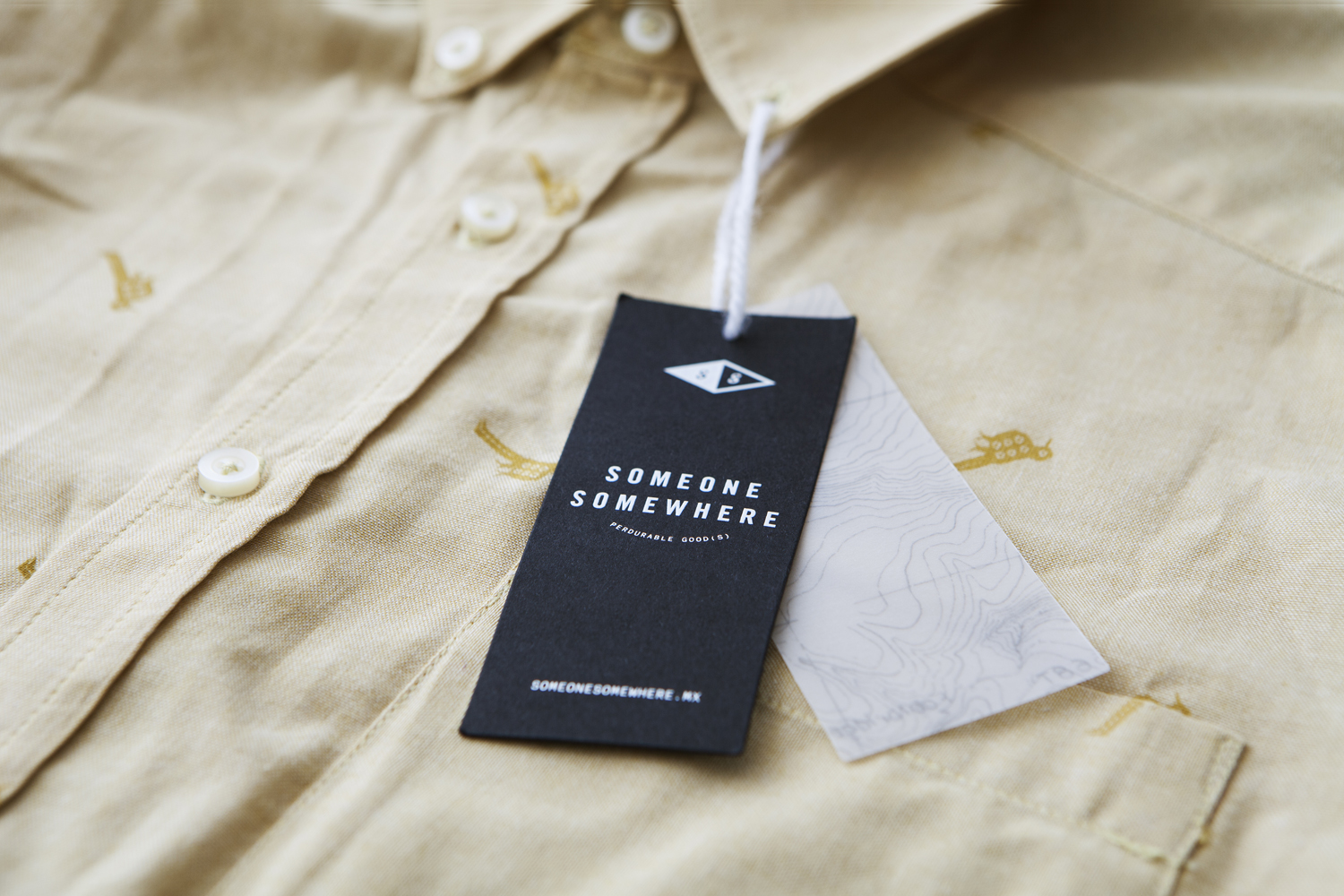 Logo, labels, business cards and tags by Sociedad Anonima for Mexican garment, bag and accessory brand Someone Somewhere