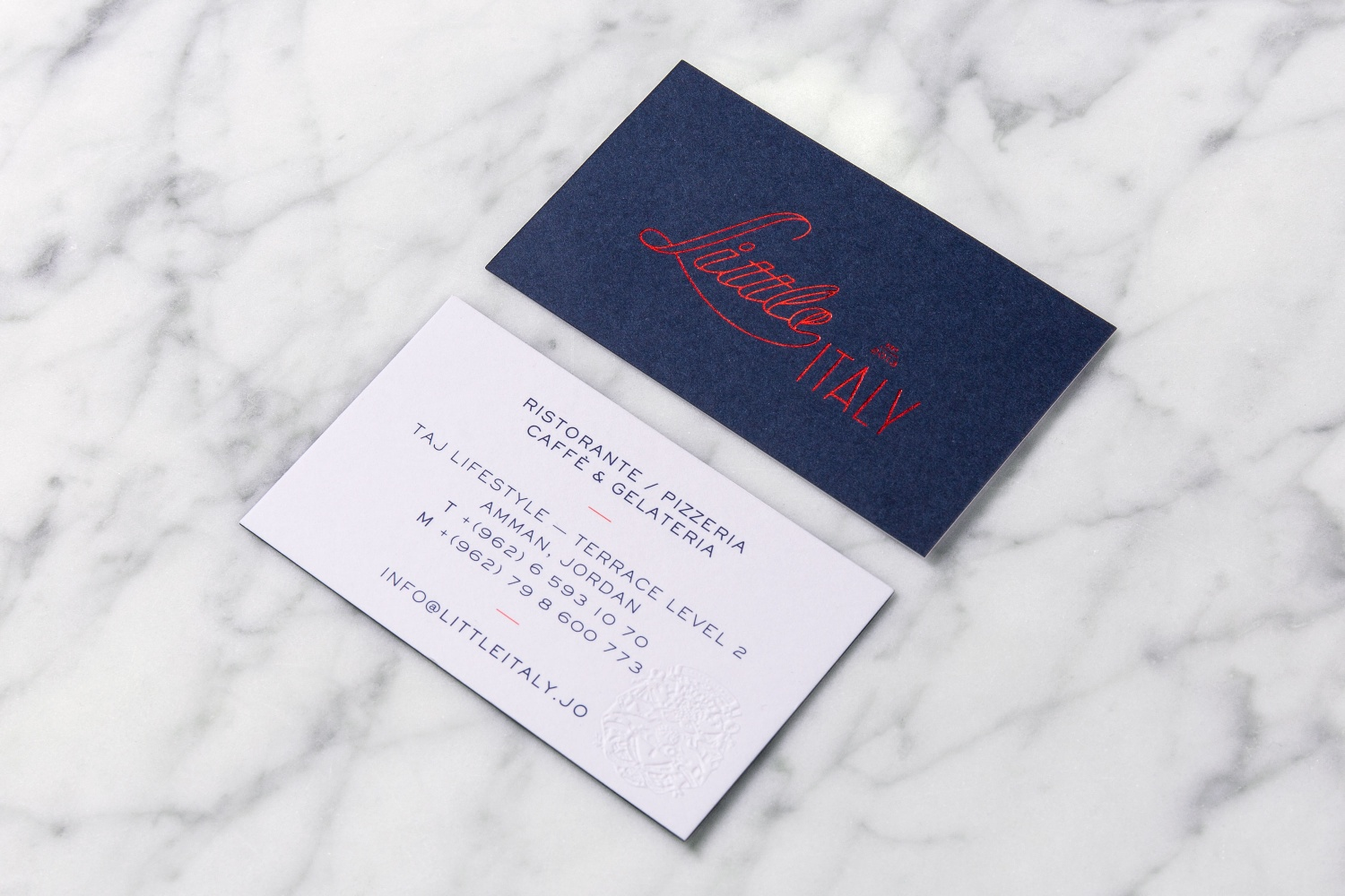 Brand identity and business cards by British studio Here Design for Amman-based restaurant Little Italy