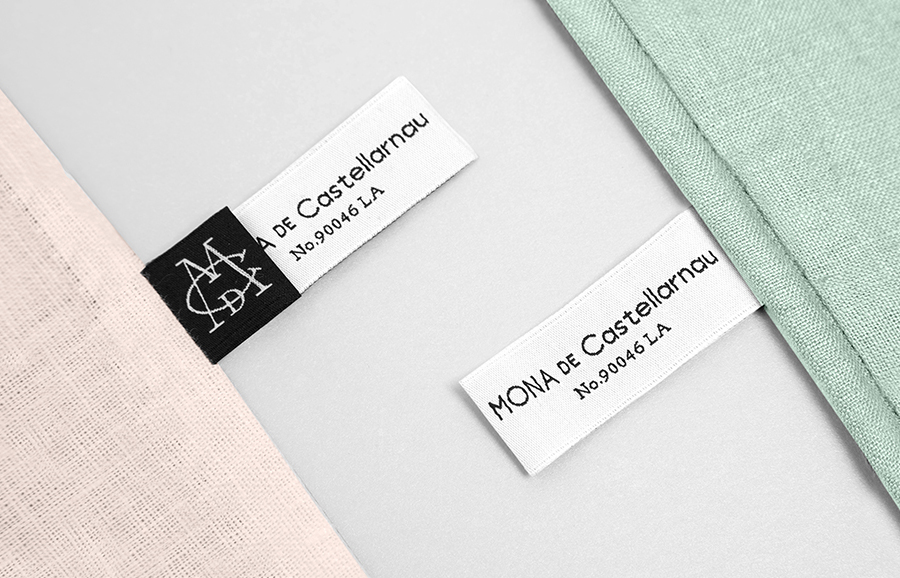 Monogram, logotype and embroidered labels for luxury lifestyle brand Mona De Castellarnau designed by Anagrama
