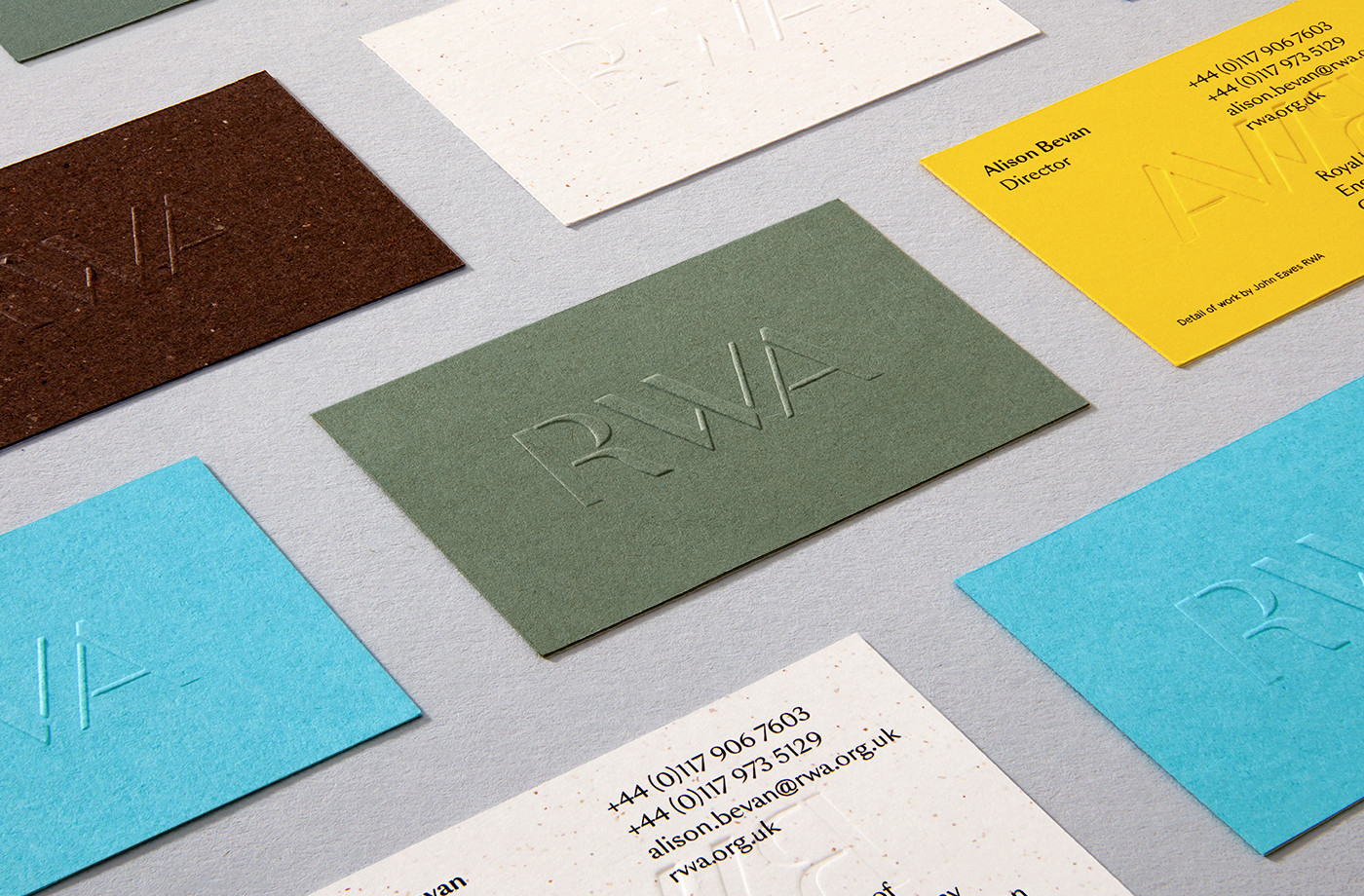 Colourful blind embossed business cards for Royal West of England Academy by Spy, United Kingdom