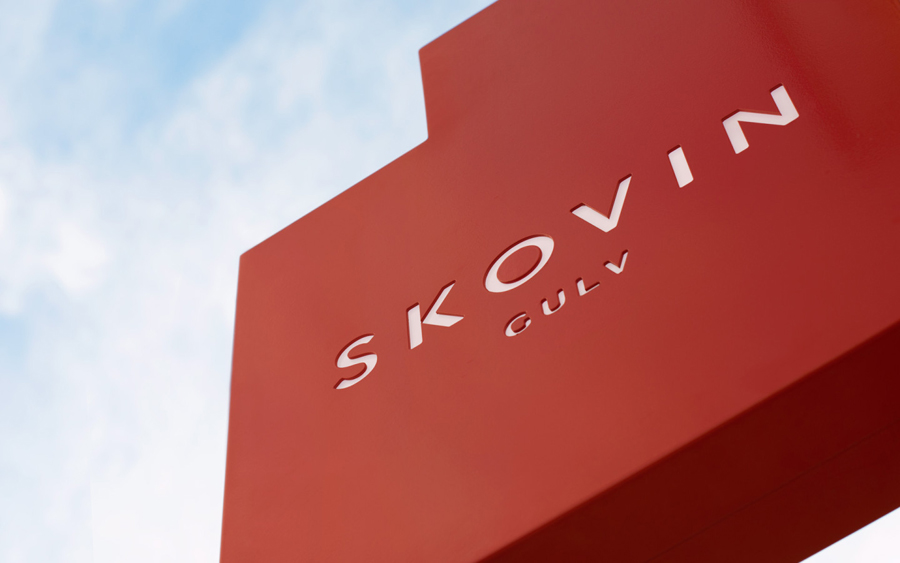Store front sign designed by Heydays for Norwegian high-end wood flooring specialist Skovin