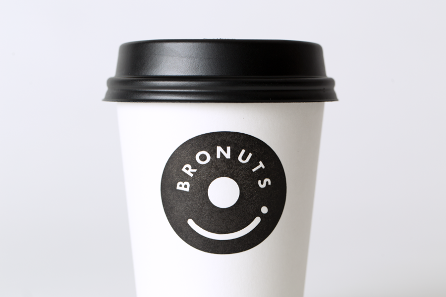 Branded coffee cup for Bronuts by Canadian graphic design studio One Plus One