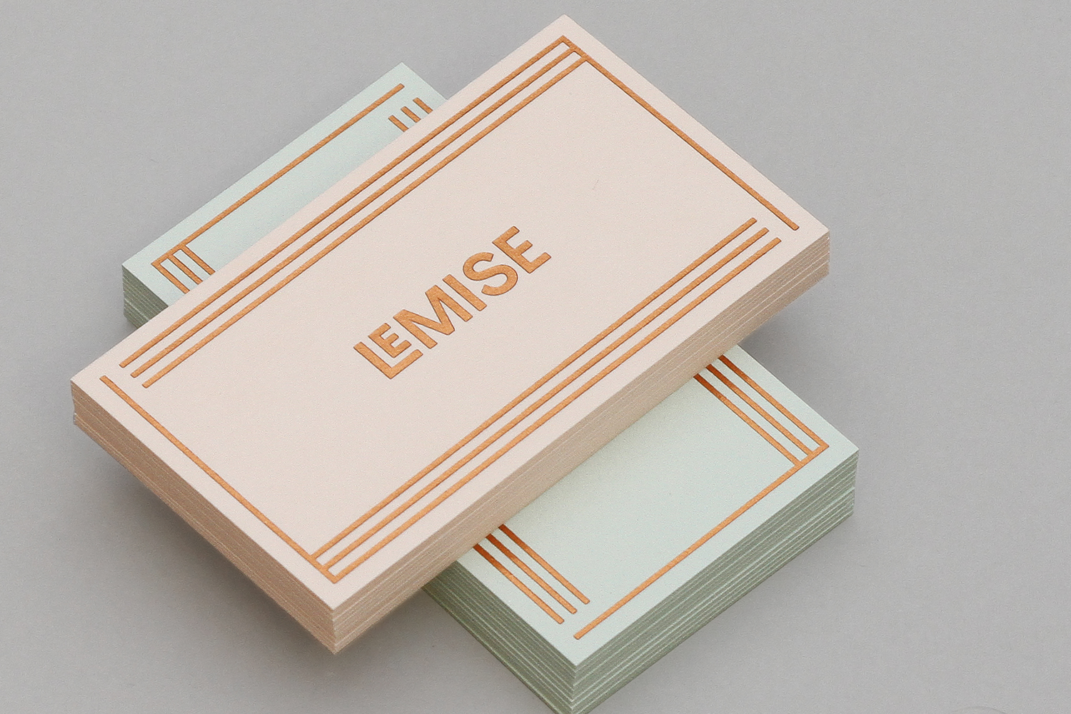Business cards for NY gallery LeMise by DIA. These feature a copper block foil over pastel substrates.