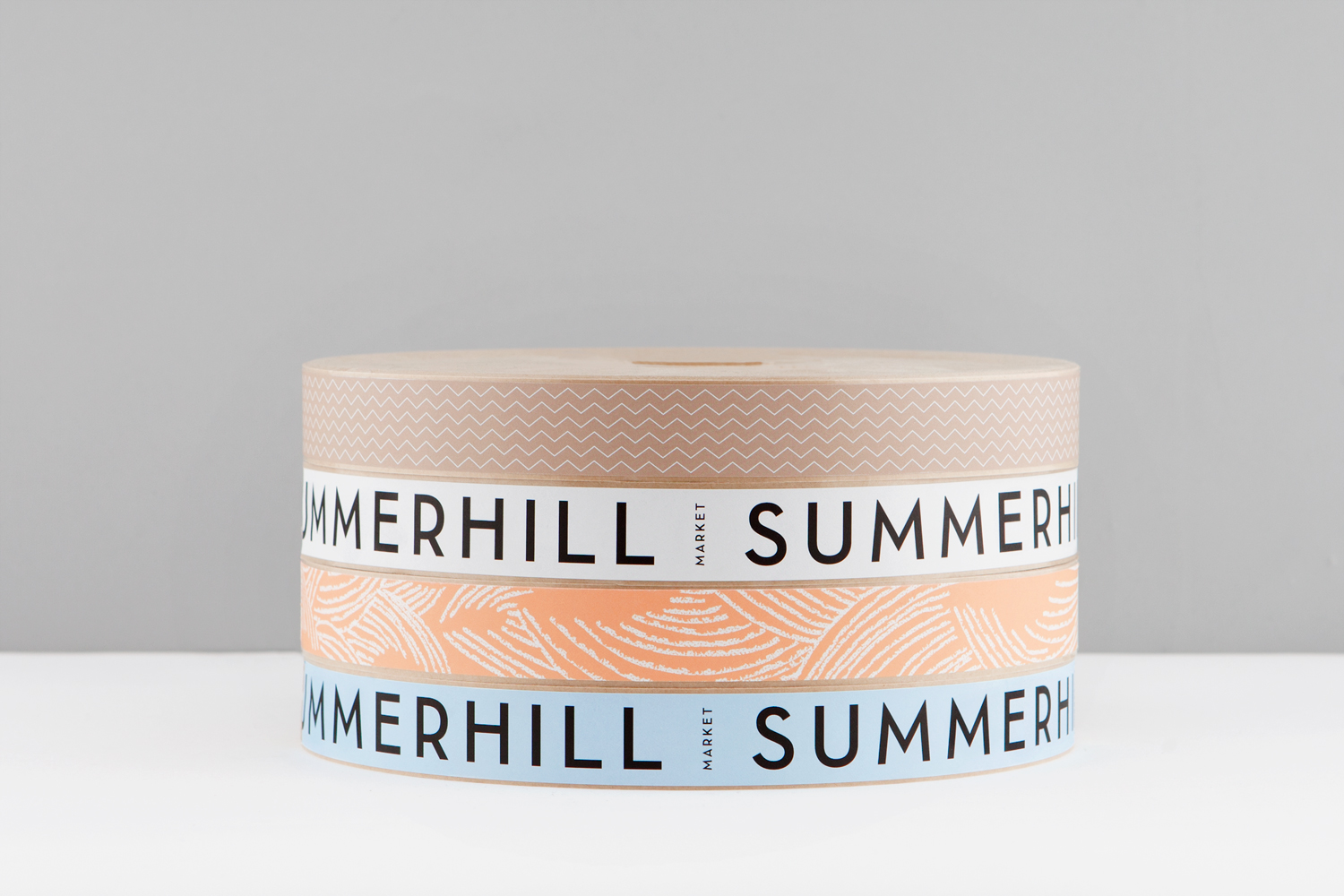 Branded adhesive tape designed by Canadian studio Blok for Toronto based boutique grocery store Summerhill Market