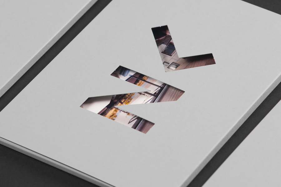 Monogram and die cut portfolio folder for architectural photographer Luka Žanić by Studio8585