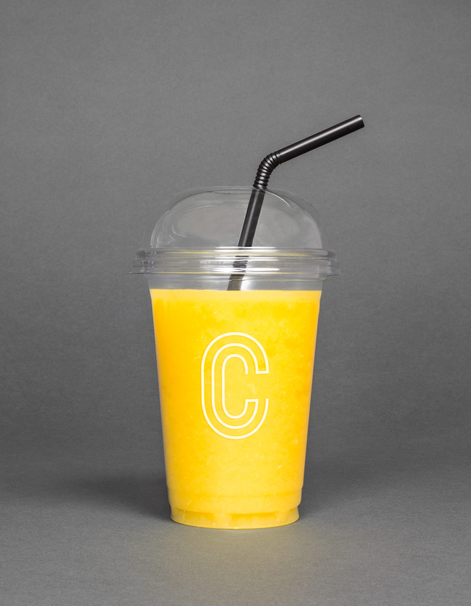 Logo and branded juice cup designed by 25ah for Stockholm cafe Caldo Coffee at the Scandic Continental