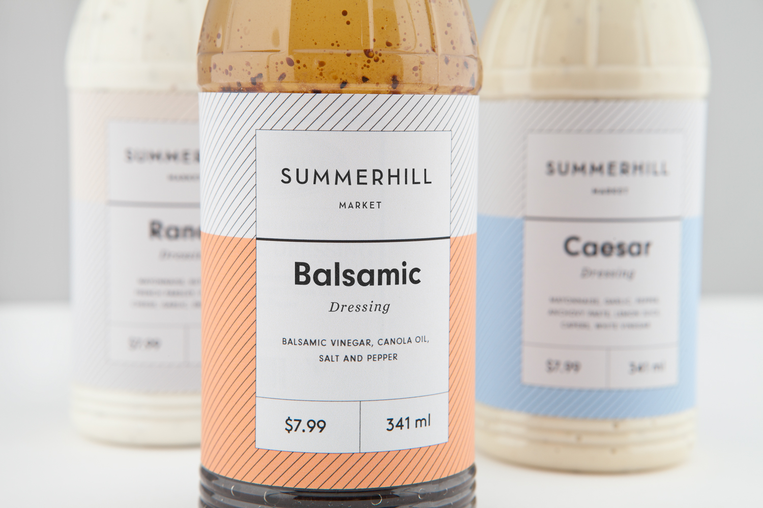 Branding and salad dressing packaging designed by Canadian studio Blok for Toronto based boutique grocery store Summerhill Market