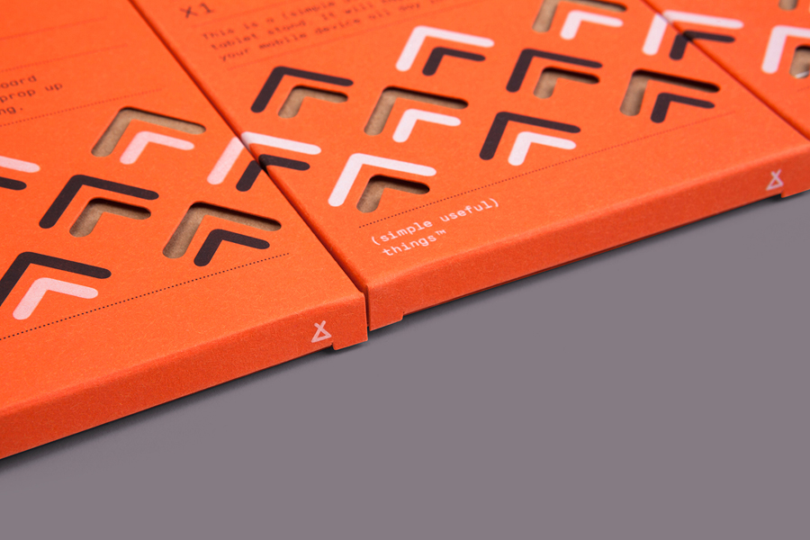 Visual identity and packaging designed by Believe In for Finchtail's mobile phone and tablet stand