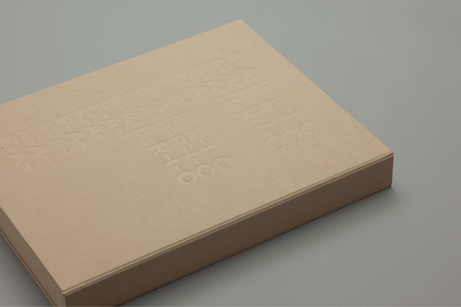 Brand identity and folder with fabric cover and blind deboss detail by Richards Partners for Auckland residential development Fabric of Onehunga