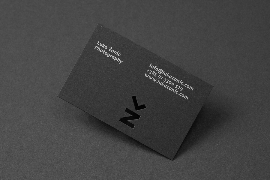 Business cards with silver ink and die cut detail by Studio8585 for architectural photographer Luka Žanić