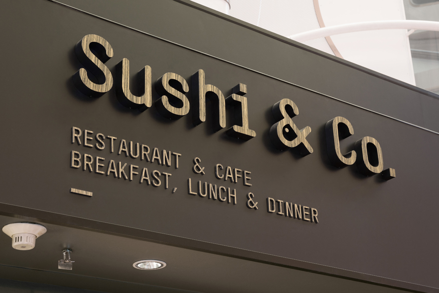 Signage for restaurant Sushi & Co. by Finnish graphic design studio Bond