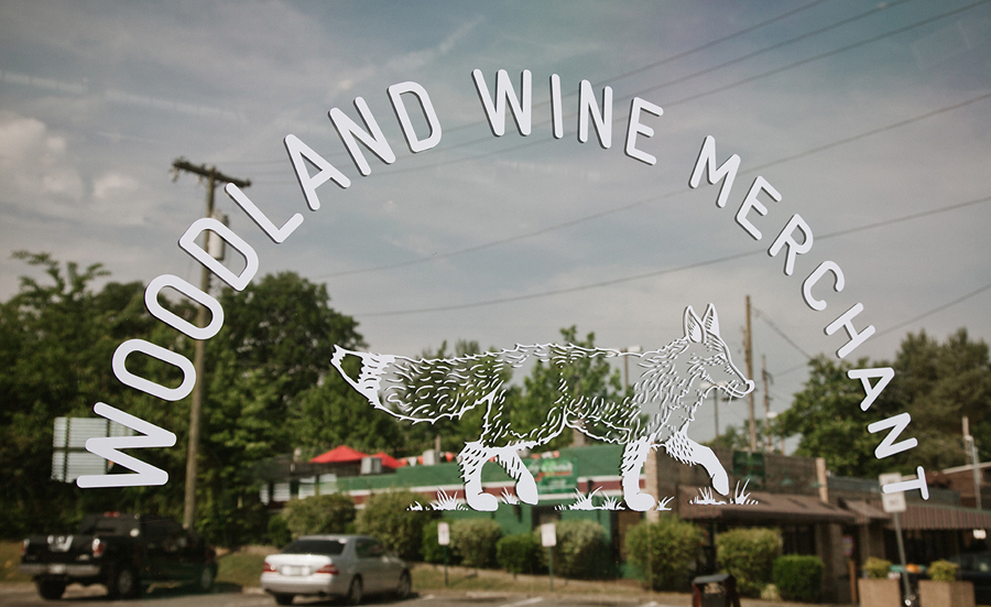 Logo and signage for Nashville based Woodland Wine Merchant by Perky Bros