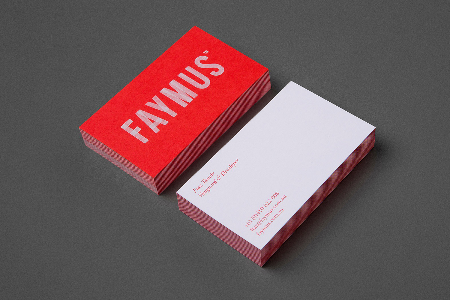 White ink and duplex business card for Faymus designed by Studio Brave