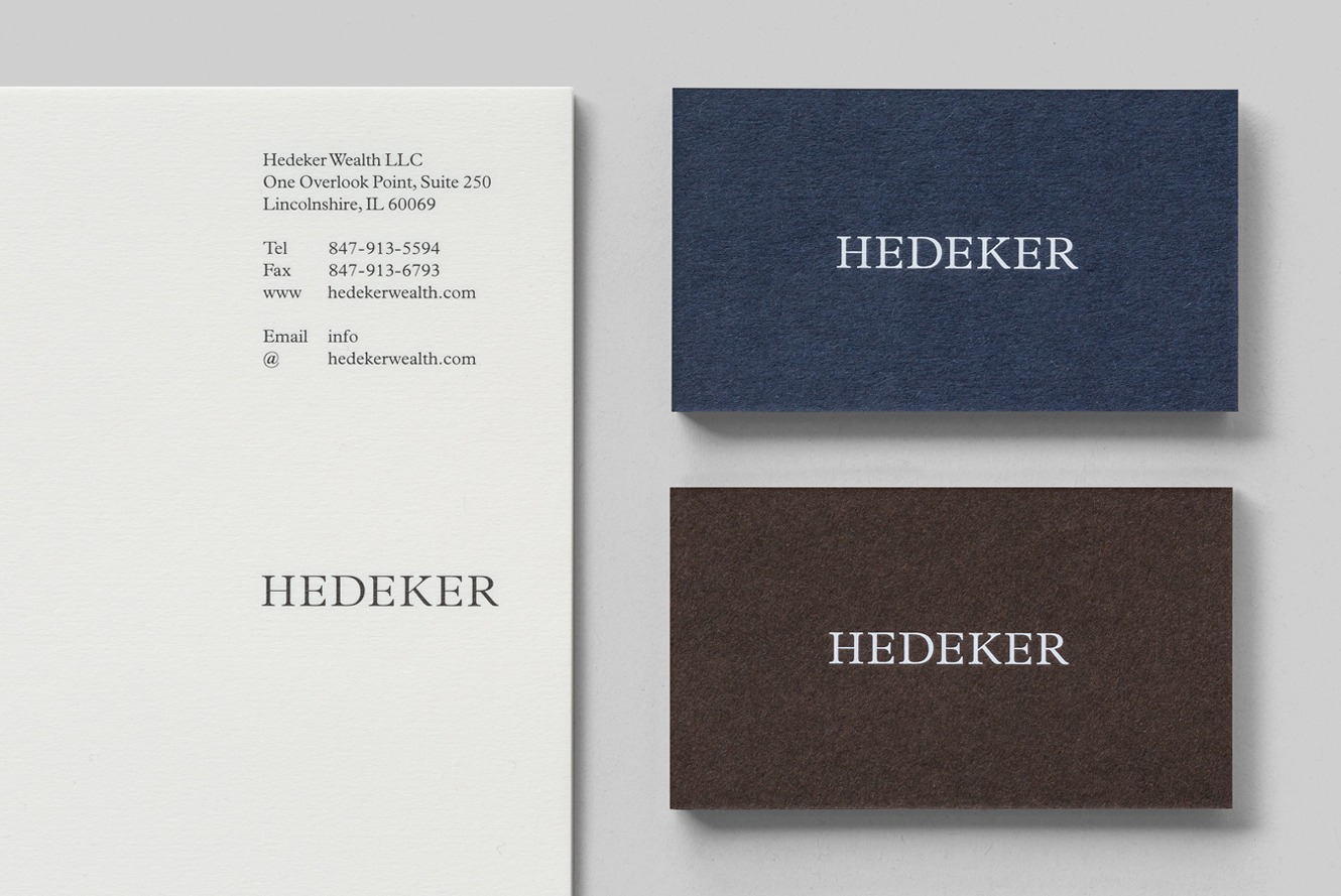Business cards for US wealth management business Hedeker by London-based Socio design. These feature a white block foil over dyed blue and brown boards.