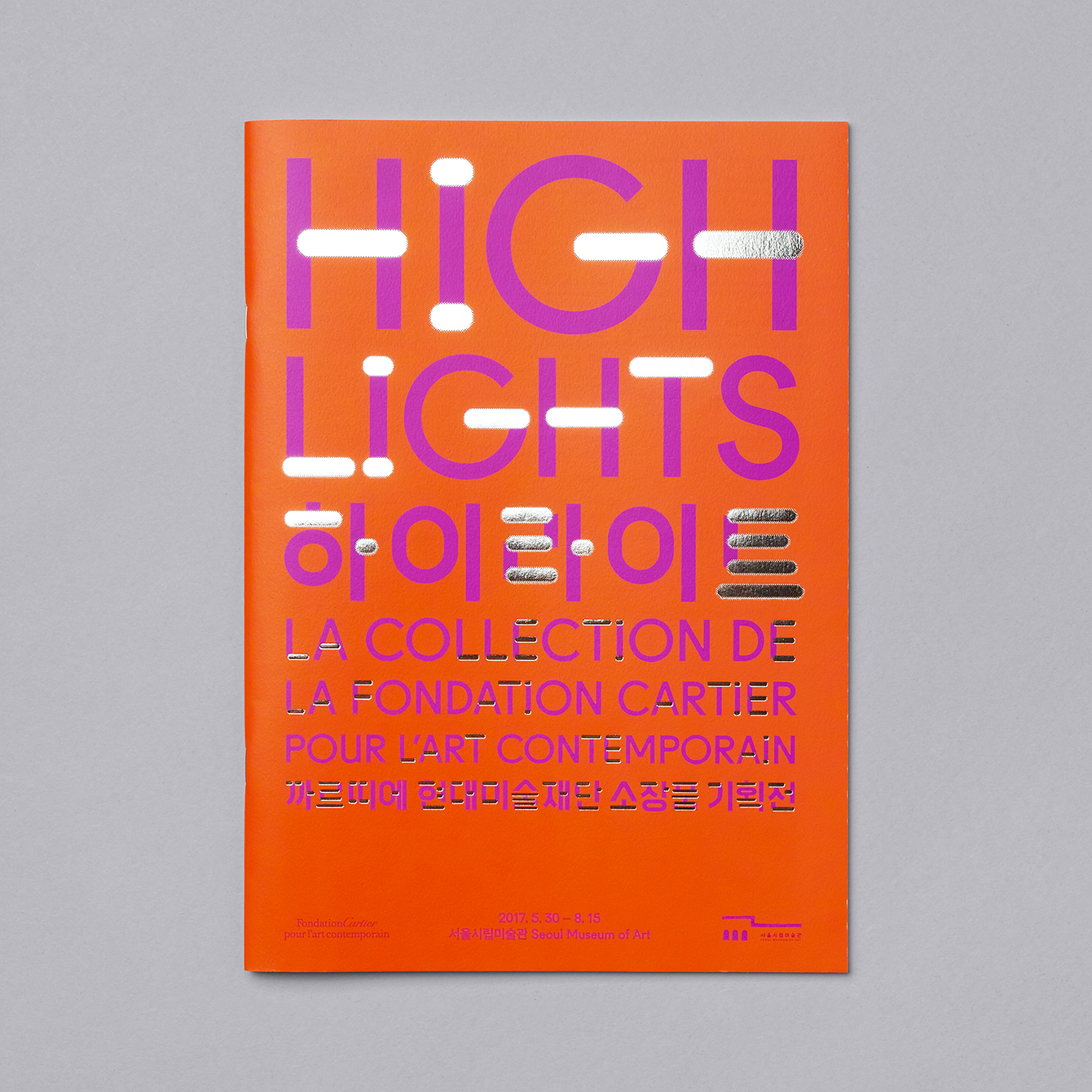 Visual identity and guide book with silver foil detail by Studio fnt for South Korean art exhibition Highlights at SeMA