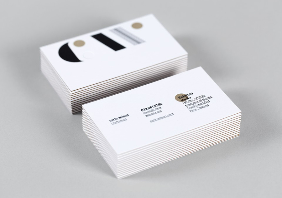 Blind embossed and triplexed business cards for Carin Wilson designed by Studio Alexander