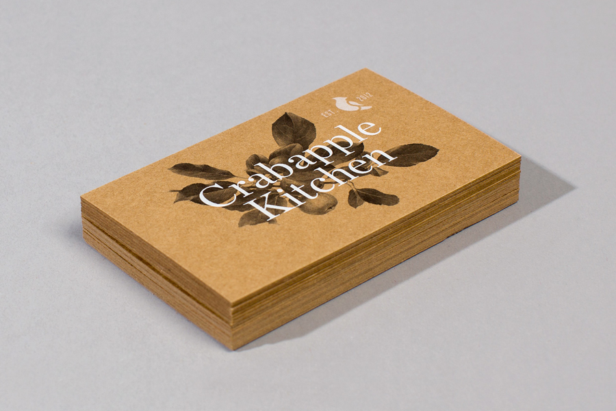 Unbleached business card design with white ink detail for Crabapple Kitchen by Swear Words