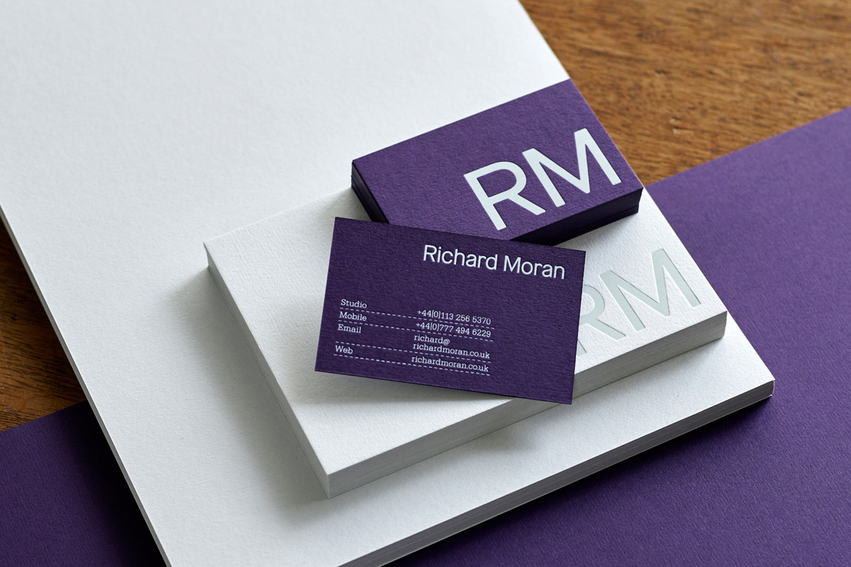 Purple card and white block foil business cards for UK based photographer Richard Moran designed by Journal