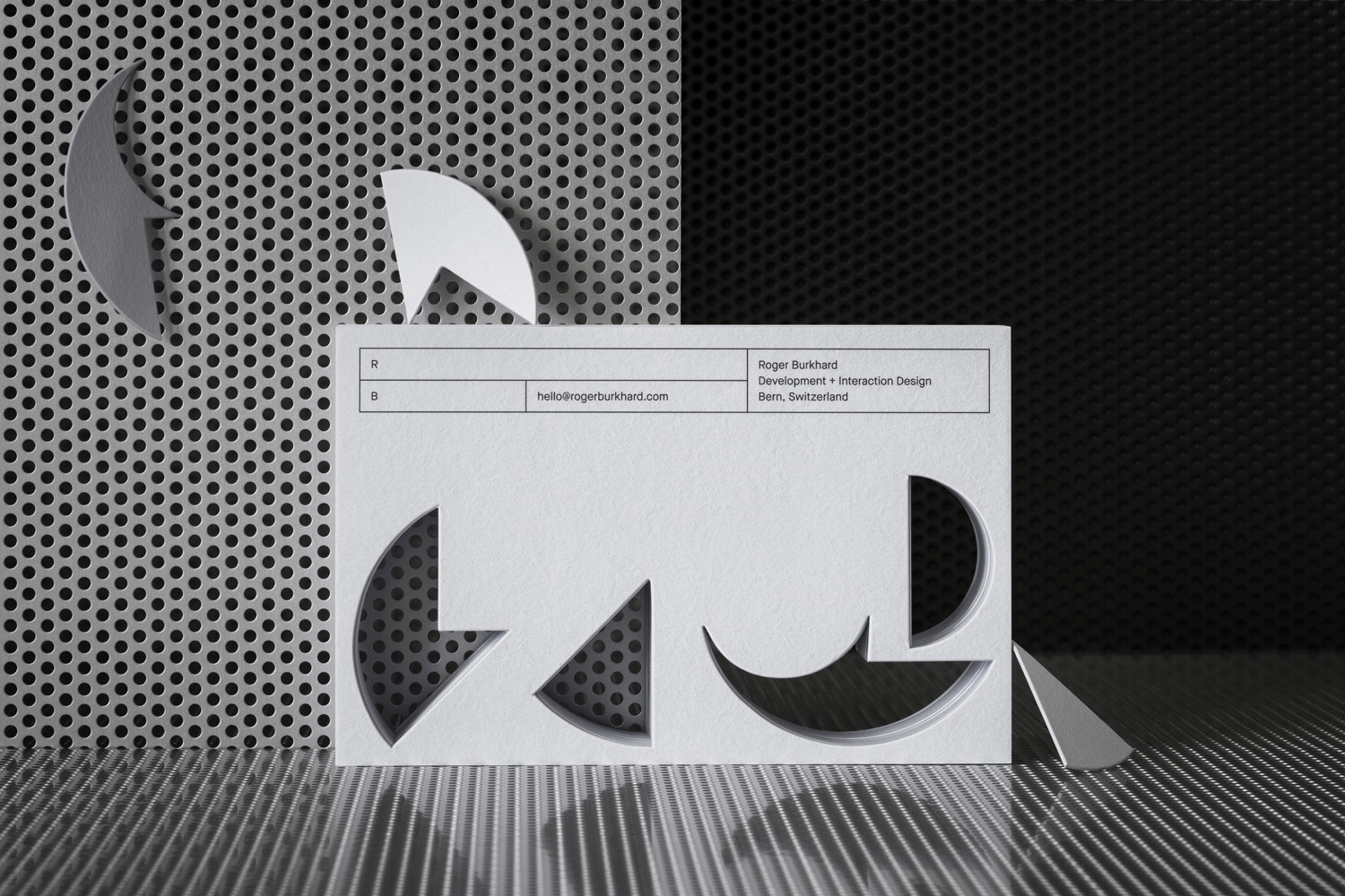 Brand identity and die cut promotional card by Lundgren+Lindqvist for Swiss web dev and interactive studio Roger Burkhard.