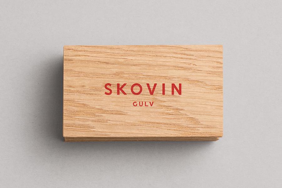 Wood veneer business cards for Skovin designed by Heydays